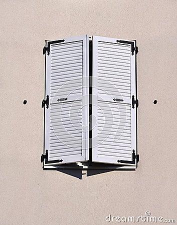 White shutters closed