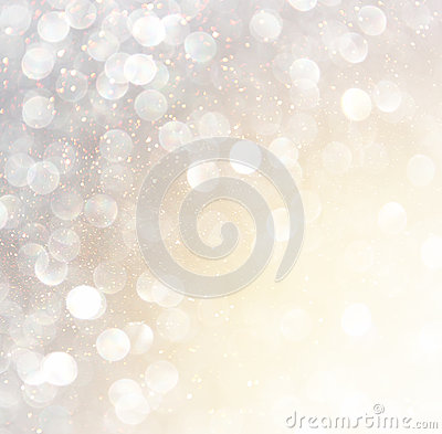 White silver and gold abstract bokeh lights. defocused background Stock Photo