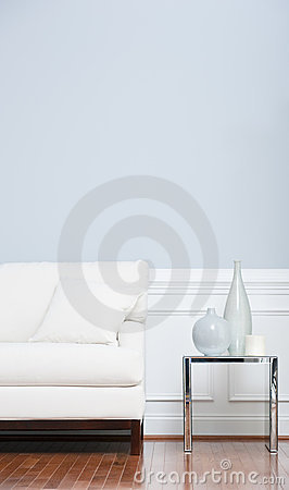 Free White Sofa And Glass End Table Against Blue Wall Stock Photography - 12731422
