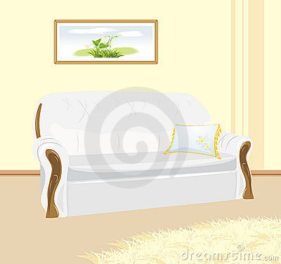 White sofa with pillow. Fragment of living room