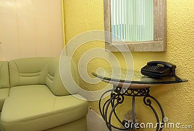 White sofa and telephone table