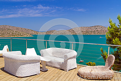 White sofas with Mirabello Bay view