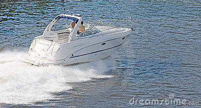 White speedboat at height of summer
