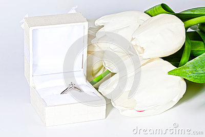White spring tulips with box with diamond ring