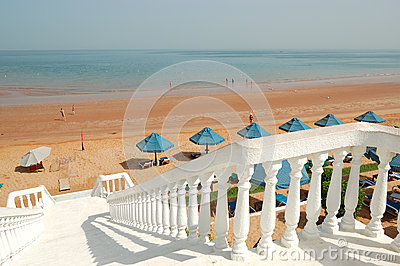White staircase at the beach of luxury hotel
