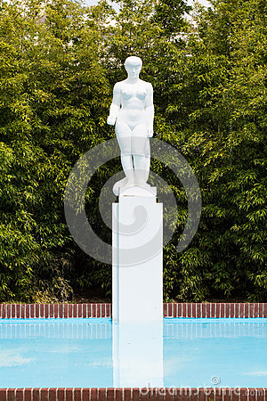 White statue and pool