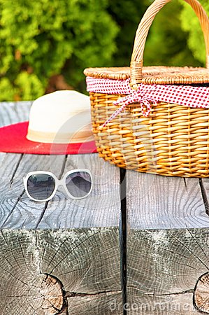 Free White Sunglasses Summer Hat And Wicker Basket On Wooden Table Stock Image - 106415291