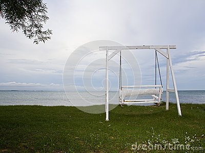 White swing on beach