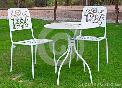 White table and chairs in lawn
