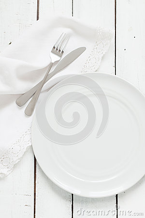 Free White Table Setting From Above. Empty Plate, Cutlery, Napkin On White. Royalty Free Stock Images - 65519599