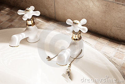 White taps in modern bathroom