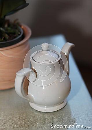 White tea pot on the table