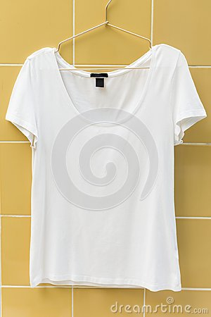 Free White Tee Hanging On The Wall Stock Photos - 104380323