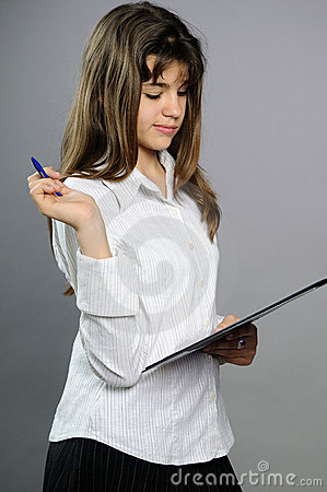 White teenager writing on paper with pen