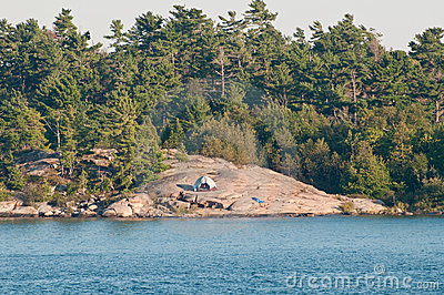 White tent on rocky island