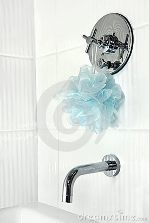 White tiled shower stall faucets