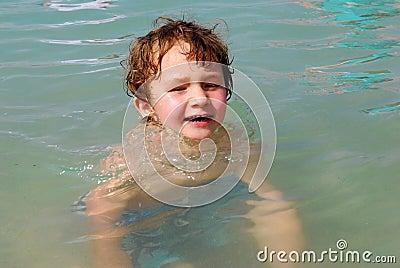 White Toddler Boy playing in Ocean