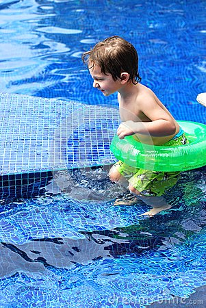 White Toddler boy in a pool with tube