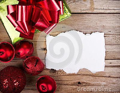 White torn paper on wooden background Christmas ornaments