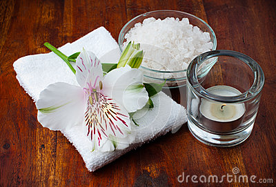 White towel, aromatic salt and flower