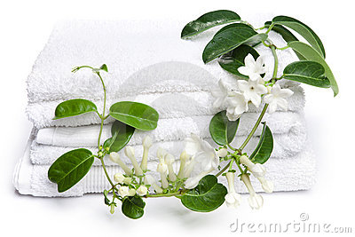White towels  with flowers for wellness