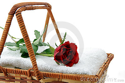 White towels and rose in basket 1