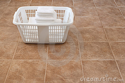 White towels stacked in a laundry basket