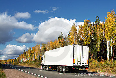 white truck on autumn highway