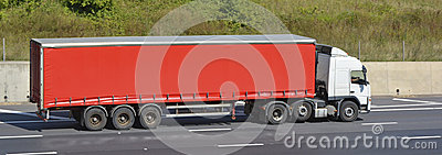 White truck with red articulated trailer