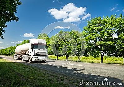 White truck on summer road