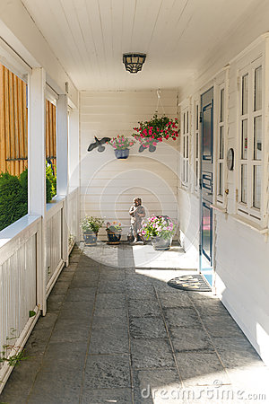 White typical wooden terrace with entrance door
