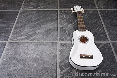 White Ukulele Black Floor Royalty Free Stock Photography