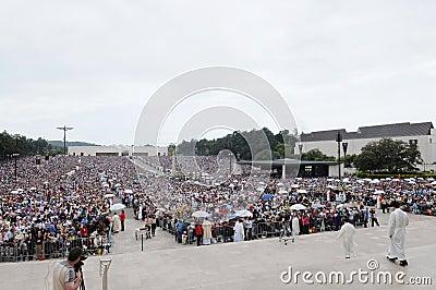 Catholic Pilgrims taking Sacred Host - Religion - Faith Editorial Photography
