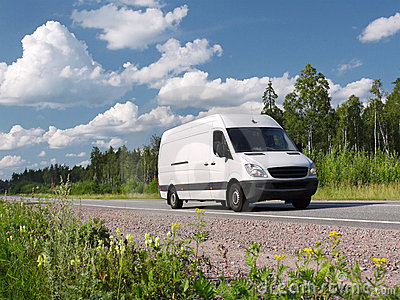 White van on summer rural highway