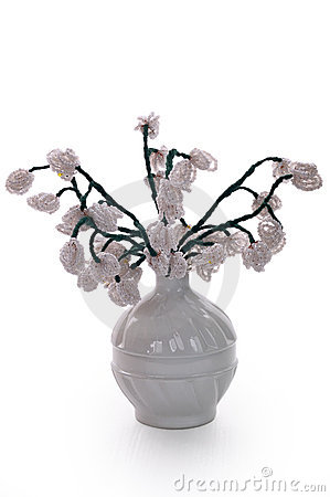 White vase with flowers from glass beads and wire