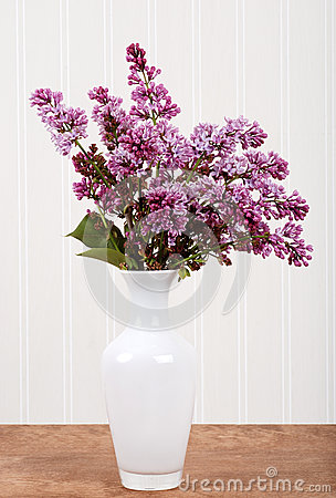 White vase with lilac flowers