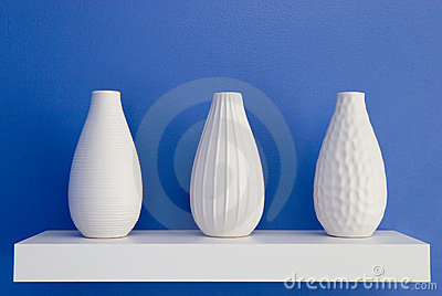 White vases on blue