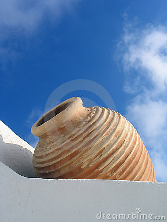 White wall, beige vase, blue sky, Santorini, Greece