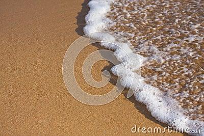 White wave on beach
