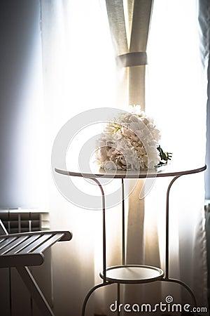 White wedding bouquet in sunlight