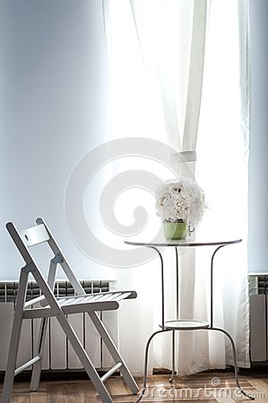 White wedding bouquet in sunlight on table