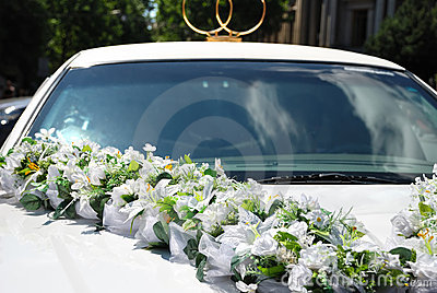 White wedding car with flowers