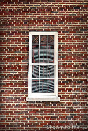 White Window Isolated by Red Brick