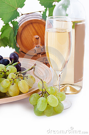 White wine bottle, glass and cask with grapes