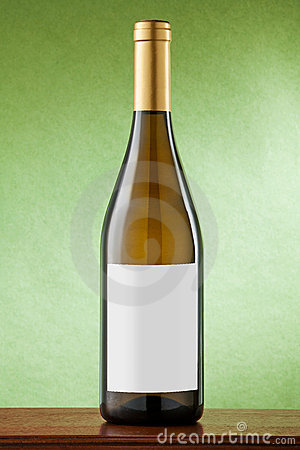 White wine bottle on green background.