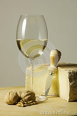 White wine glass and cheese