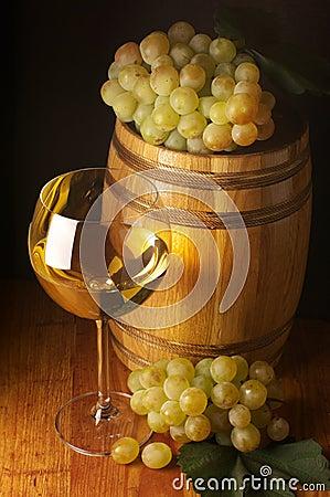 White wine, grape and barrel