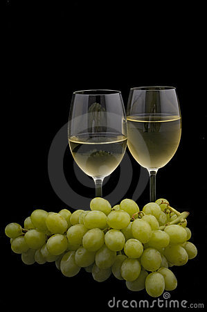 White wine and grapes on black