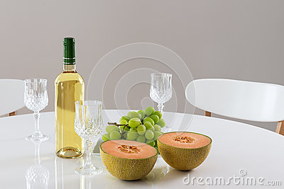 White wine, melon and grapes
