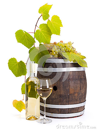 White wine with old barrel and grapes